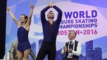Meagan Duhamel and Eric Radford, of Canada, react to their scores after competing in the pairs free skate during the World Figure Skating Championships, Saturday, April 2, 2016, in Boston. (Elise Amendola/AP)