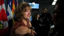 Thalidomide victim Mercedes Benegbi is greeted during a news conference supporting NDP MP Libby Davies motion introduced on Monday calling for compensation for Thalidomide survivors November 25, 2014 on Parliament Hill in Ottawa. (Dave Chan/Dave Chan)