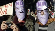 "Demonstrators wearing Italian premier Silvio Berlusconi masks are seen in downtown Rome on Dec. 5, 2009 at a ""No Berlusconi-Day"" rally asking for Berlusconi's resignation. (Riccardo De Luca)"