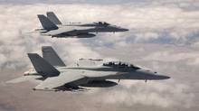 Two USN F/A-18 Super Hornets fly to the Abbotsford Air Show. (Boeing)