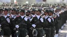 Members of Iran's Revolutionary Guards parade in Tehran in this Sept. 22, 2007 file photo. (HASAN SARBAKHSHIAN/AP)