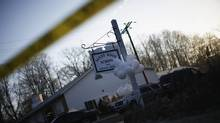 Balloons hang from the Sandy Hook Elementary School sign in Sandy Hook in Newtown, Connecticut December 15, 2012. (ERIC THAYER/REUTERS)
