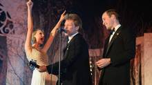 Britain's Prince William, the Duke of Cambridge, right, sings with Taylor Swift, left, and Jon Bon Jovi at the Centrepoint Gala Dinner at Kensington Palace in London, Tuesday Nov. 26, 2013. (Dominic Lipinski/AP)