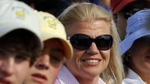 IBM CEO Virginia Rometty watches the fourth round of the Masters golf tournament from the gallery on the 18th green Sunday, April 8, 2012, in Augusta, Ga. (Chris O'Meara)