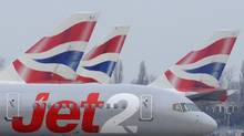 A Jet2 aircraft taxis past British Airways aircraft at Terminal 5 of Heathrow Airport in west London March 21, 2010. Last week, Jet2 banned six passengers after a drunken incident on a flight from Newcastle to Tenerife. (© Toby Melville / Reuters)