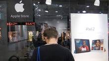 A customer looks at products at an alleged fake Apple store in Kunming, in southwest China's Yunan province. (BirdAboard/AFP/Getty Images)