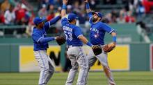 Toronto Blue Jays center fielder Anthony Gose (left) celebrates with left fielder Melky Cabrera (53) and right fielder Jose Bautista (19) after defeating the Boston Red Sox 7-2 at Fenway Park. (Greg M. Cooper/USA Today Sports)
