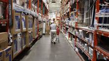A man pushes his shopping cart down an aisle at a Home Depot store in New York. (SHANNON STAPLETON/Reuters)