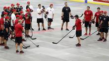 Head coach Mike Babcock, from Saskatoon, Sask., gives instruction during a ball hockey training session at the Canadian national men's team orientation camp in Calgary, Alta., Monday, Aug. 26, 2013 (Jeff McIntosh/CP)