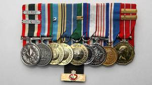 Veteran Tom White medals (L-R) Special Service Medal-2 Bars, Canadian Peace Service Medal, United Nations Emergency Force 1, United Nations Truce Supervision - Palestine, United Nations- Congo, Queen's Silver Jubilee, Canada 125th Birthday, Queen's Golden Jubilee, Canadian Decoration- 2 Bars, and (bottom) Minister of Veterans Affairs Commendation , taken 9 November 2010.