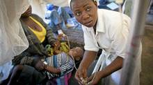 A nurse fixes the IV drip of a young boy who is suffering from malaria at a hospital in the city of Lubumbashi, in the Democratic Republic of the Congo, May 12, 2012. (John Lehmann/Globe and Mail/John Lehmann/Globe and Mail)