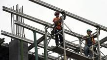 Construction workers in Montreal are seen in this file photo. Statistics Canada released its latest employment figures on Friday. (Ryan Remiorz/The Canadian Press)