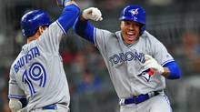 Toronto Blue Jays pitcher Marcus Stroman is congratulated by Jose Bautista after hitting a fourth inning solo home run against the Atlanta Braves at SunTrust Park in Atlanta, on May 18, 2017. (Scott Cunningham/Getty Images)
