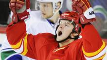 Calgary Flames' Roman Horak celebrates his goal against the Vancouver Canucks as Alexander Edler looks at the puck in the net during the second period of their NHL hockey game in Calgary, Alberta February 11, 2012. REUTERS/Mike Sturk (Mike Sturk/Reuters)