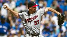 Minnesota Twins Mike Pelfrey pitches to the Toronto Blue Jays during the fifth inning of their MLB American League baseball game in Toronto, July 6, 2013. (MARK BLINCH/REUTERS)