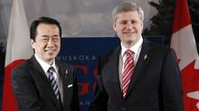 Prime Minister Stephen Harper, right, and Japanese Prime Minister Naoto Kan at the G8 Summit in Huntsville, Ont., in 2010. (CHRIS WATTIE/REUTERS/CHRIS WATTIE/REUTERS)