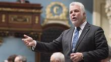 Quebec Premier Philippe Couillard responds to the Opposition during question period Wednesday, February 24, 2016 at the legislature in Quebec City. (Jacques Boissinot/THE CANADIAN PRESS)