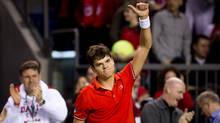 Canada's Milos Raonic celebrates his straight sets win over France's Julien Benneteau during a Davis Cup tennis singles match in Vancouver, B.C., on Friday February 10, 2012. (DARRYL DYCK/THE CANADIAN PRESS)