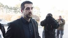 Marco Muzzo arrives with family at the court house for his sentencing hearing in Newmarket, Ont., on Tuesday, February 23, 2016. (Nathan Denette/THE CANADIAN PRESS)