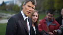 Vancouver Mayor Gregor Robertson speaks during a news conference at English Bay in Vancouver, B.C., on Friday April 10, 2015, after bunker fuel began leaking from a bulk carrier cargo ship Wednesday. (DARRYL DYCK FOR THE GLOBE AND MAIL)