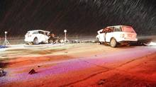 Vehicles lie damaged after a crash near Red Deer and Innisfail on March 4, 2012, that killed four workers from the Philippines. (RCMP/THE CANADIAN PRESS)