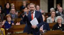 NDP Leader Tom Mulcair argues Justin Trudeau is aligning himself with the Tories to suppress the civil liberties of advocacy groups. (Sean Kilpatrick/THE CANADIAN PRESS)