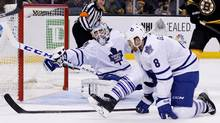 Toronto Maple Leafs goalie Jonathan Bernier (45) attempts to block a shot by Boston Bruins center David Krejci (not pictured) during the second period at TD Banknorth Garden. (Greg M. Cooper/USA Today Sports)