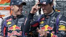Red Bull driver Sebastian Vettel and Red Bull driver Mark Webber prepare to pose during the official driver photo of the Australian Grand Prix (John Donegan/The Associated Press)