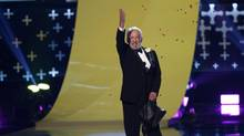 "Actor Donald Sutherland accepts the choice movie villain award for ""The Hunger Games: Catching Fire"" onstage during the Teen Choice Awards 2014 in Los Angeles, California August 10, 2014. (MARIO ANZUONI/REUTERS)"