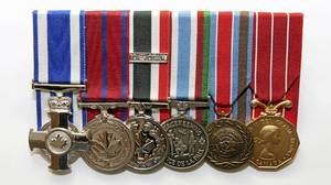 Tom Hoppe's medals are seen left to right in his home on November 6, 2010: Meritorious Service Cross, given for leadership and bravery under fire during 1993 Bosnian tour; Medal of Bravery, for rescuing three kids trapped under sniper fire during the 1993 Bosnian tour; Special Service Medal, for NATO tour in Europe 1985-1990; Peace Keeping Medal, given to all soliders who serviced on a peace keeping tour; United Nations Protection Force Medal, 1993 Bosnia; Canadian Forces Decoration, for 12 years of good service
