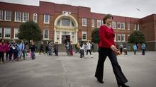 Christy Clark announced on Monday $584-million in funding to seismically upgrade 45 at-risk B.C. schools, leaving 102 high-priority schools to be addressed. Ms. Clark and her ministers scramble to maximize their agendas as time dwindles before the writ drops (Darryl Dyck for The Globe and Mail)