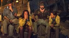 In this image released by CBS, contestants, from left, Jeff Varner, Sarah Lacina, Zeke Smith and Debbie Wanner appear at the Tribal Council portion of the competition series Survivor: Game Changers. Survivor contestant Varner, who outed fellow competitor Smith as transgender on the Wednesday night, April 12, 2017, episode of the CBS reality competition, has been fired from his real estate job. (Jeffrey Neira/AP)