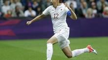 Canada's Christine Sinclair celebrates her goal against Britain during their quarterfinal women's soccer match. (Hussein Malla/AP)