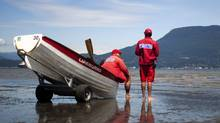 Lifeguards at Locarno Beach in Vancouver, British Columbia, Monday July 4, 2011. (Rafal Gerszak for The Globe and Mail/Rafal Gerszak for The Globe and Mail)