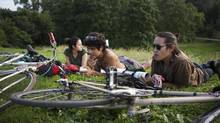 July 4, 2013 - TORONTO: (left to right) Morena Lopez, Vlad Rudakov and Afo G enjoy a beer at Trinity Bellwoods Park in Toronto. (Della Rollins For The Globe and Mail)