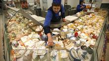 A worker arranges cheese for sale at a grocery store in Moscow August 7, 2014. Moscow imposed a total ban on imports of many Western foods on Thursday in retaliation against sanctions over Ukraine, a stronger than expected measure that isolates Russian consumers from world trade to a degree unseen since Soviet days. (MAXIM ZMEYEV/REUTERS)