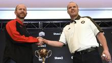 Calgary Stampeders head coach Dave Dickenson, left, and Ottawa Redblacks head coach Rick Campbell shake hands before they take part in press conferences in Toronto on Wednesday, November 23, 2016. (Nathan Denette/THE CANADIAN PRESS)
