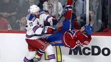 New York Rangers' John Moore, left, takes Montreal Canadiens' Dale Weise into the boards during first period NHL playoff action in Montreal on Tuesday May 27, 2014. (Ryan Remiorz/THE CANADIAN PRESS)