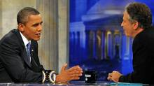 U.S. President Barack Obama chats with Daily Show host Jon Stewart during a commercial break in taping on Oct. 27, 2010 in Washington. (Pool/Getty Images)