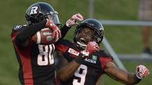 Ottawa Redblacks' Chris Williams (80) celebrates with Ernest Jackson (9) after his touchdown against the Montreal Alouettes during first half CFL action on Friday, Aug. 19, 2016 in Ottawa. (Justin Tang/THE CANADIAN PRESS)