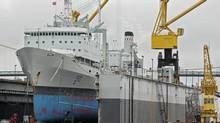 HMCS Preserver, the navy's 40-year-old Halifax-based supply ship, rests at drydock at the Irving-owned Halifax Shipyards. (ANDREW VAUGHAN/THE CANADIAN PRESS)