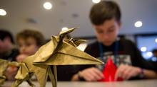 Joshua Lewis-Sandy folds origami piece during the Origami Canada Convention in Vancouver on Sunday. (Ben Nelms for the Globe and Mail)