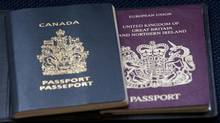 A Canadian and United Kingdom passport. (Adrian Wyld/THE CANADIAN PRESS)