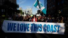 Protesters march during a rally held to show opposition to the Enbridge Northern Gateway pipeline in Vancouver, B.C., on Tuesday June 17, 2014. (DARRYL DYCK/THE CANADIAN PRESS)