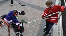 The NHL returns to Winnipeg. An impromptu ball hockey game breaks out as fans sporting old Jets memorabilia gathered at Portage and Main to hear and cheer the announcement.