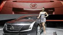 A model stands next to a Cadillac ELR at Auto China 2012. (JASON LEE/REUTERS)