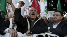 Protesters shout slogans during an anti-bailout rally outside the parliament in Nicosia March 19, 2013. Cypriot lawmakers overwhelmingly rejected a deeply unpopular tax on bank deposits on Tuesday. (YORGOS KARAHALIS/REUTERS)