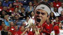 Canada fans react during the Davis Cup semifinal tennis match between Janko Tipsarevic of Serbia and Milos Raonic of Canada, in Belgrade, Serbia, Friday, Sept. 13, 2013. (Darko Vojinovic/AP)