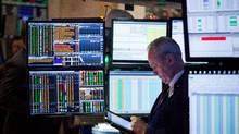 A trader works on the floor of the New York Stock Exchange (NYSE) in New York on Tuesday, Jan. 3, 2017. (Michael Nagle/Bloomberg News)