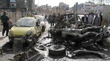 People look at destroyed and damaged vehicles after an explosion on al-Thawra Street in Damascus, Syria, Saturday, May 5, 2012. According to eyewitnesses, an explosive device was planted underneath a military car went off near the Social Military Institution, causing material damage only. (Bassem Tellawi/AP/Bassem Tellawi/AP)